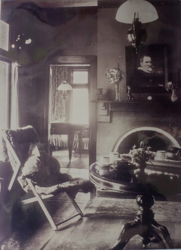 Inside CJ Dennis' home, view of parlour.