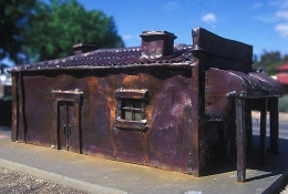 A metal re-creation of the Auburn Hotel, in Auburn South Australia, once owned by C.J. Dennis' father, now stands on the original Hotel site as a unique memorial to CJ Dennis.